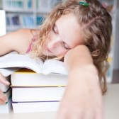 http://www.123rf.com/photo_9926055_pretty-female-tired-exhausted-sleepy-college-student-taking-a-nap-in-a-library.html