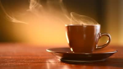 stock-footage-coffee-or-tea-brown-cup-of-hot-beverage-with-steam-espresso-coffee-closeup-hd-video-footage
