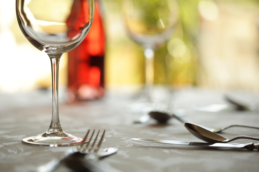Wine glass and place setting in a restaurant
