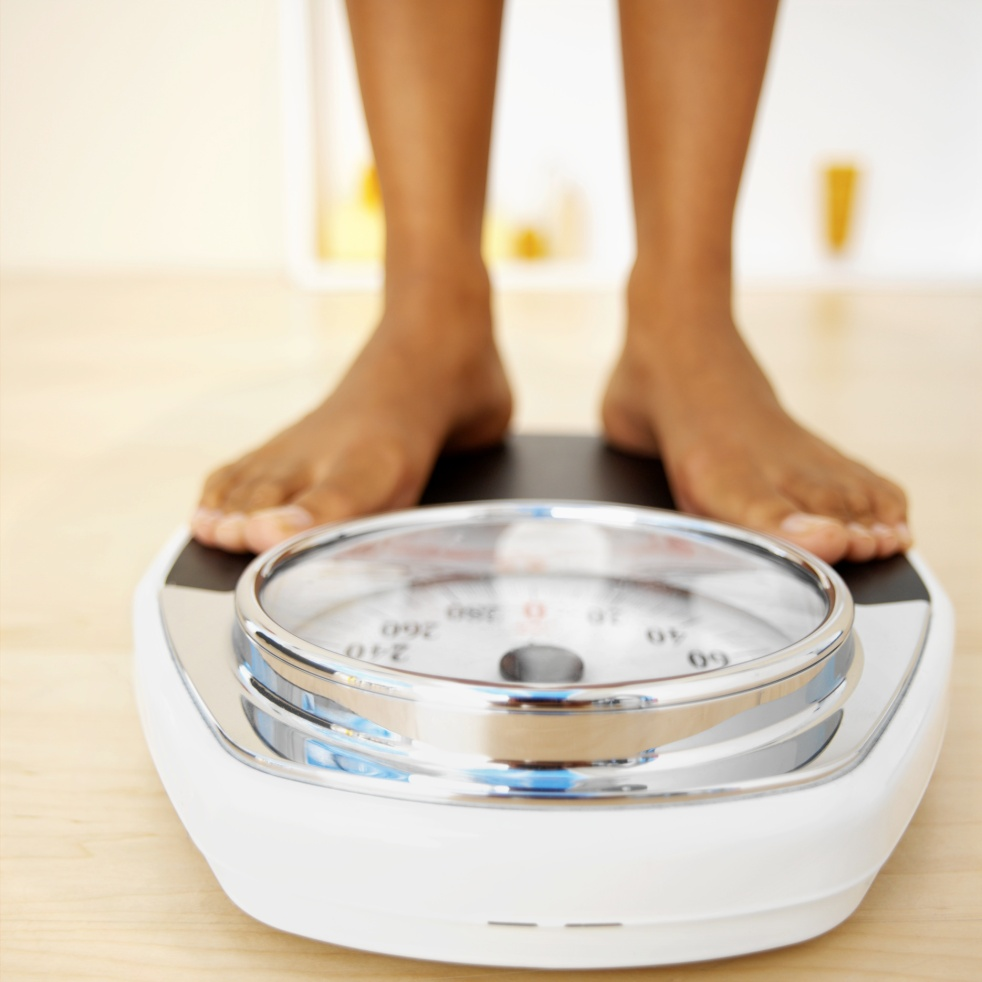 Close-up of a woman standing on a weighing scales